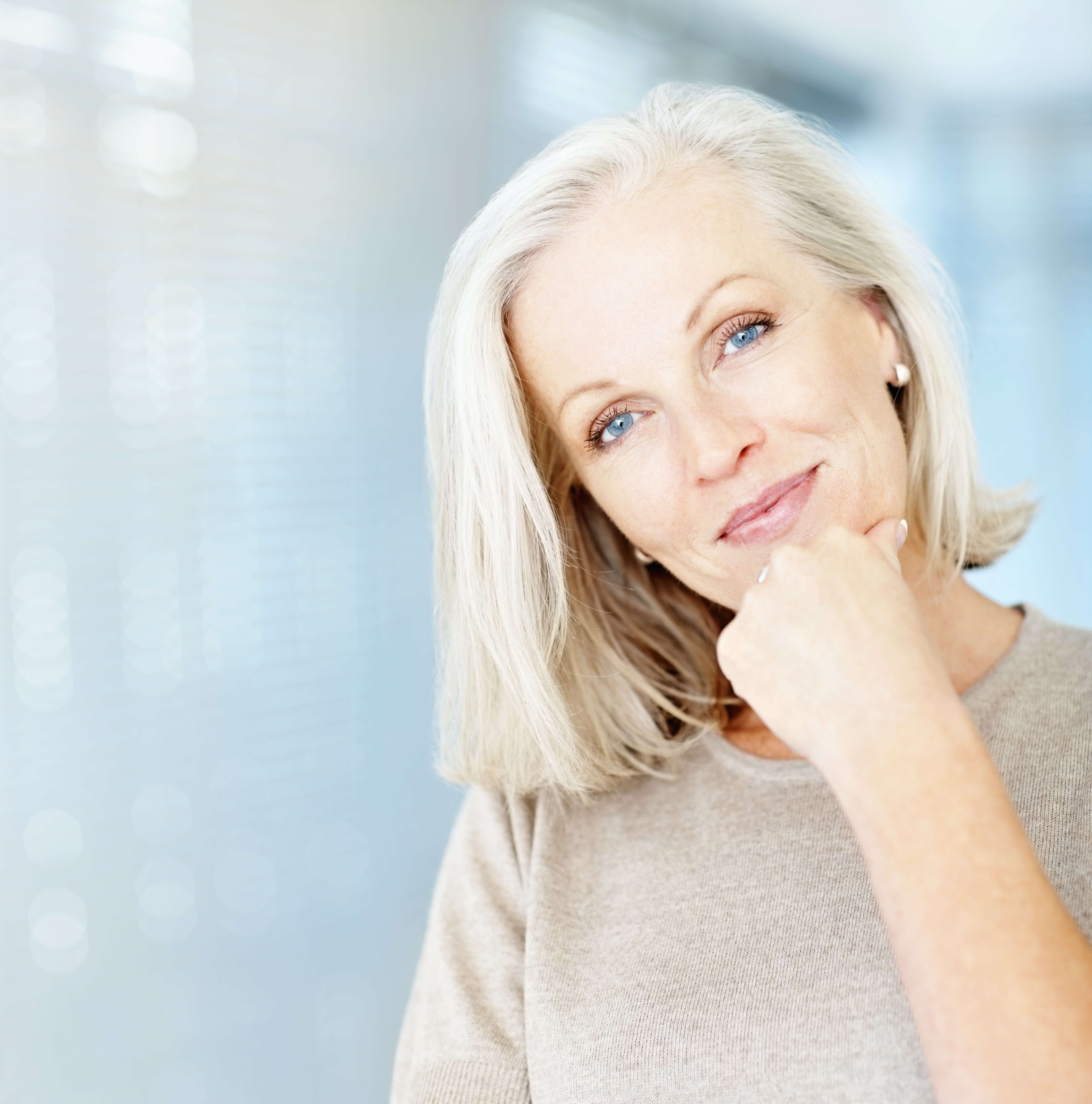 Portrait of a pretty mature woman with copy space
